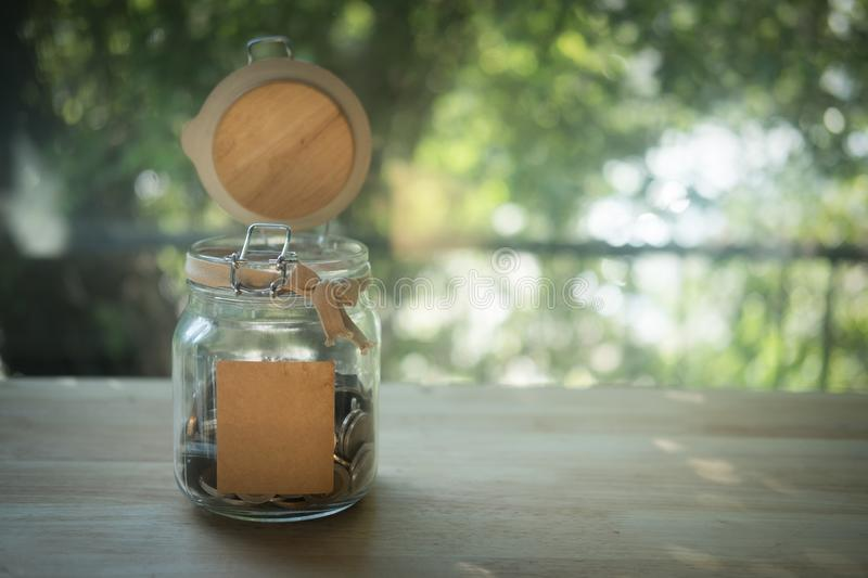 Thai baht in a glass jar stock image