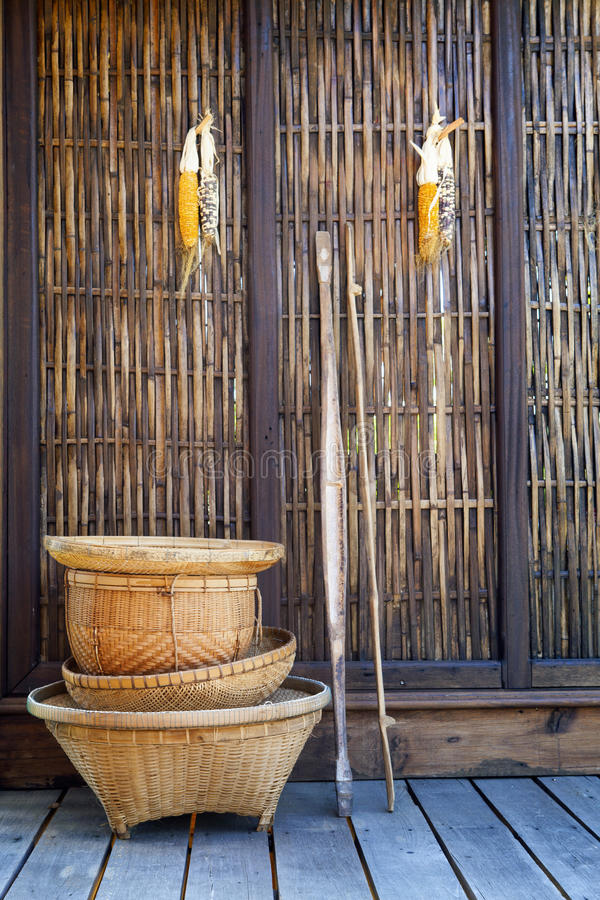 Thai bamboo basket hand craft with wood wall rural home scene i. N thailand royalty free stock image
