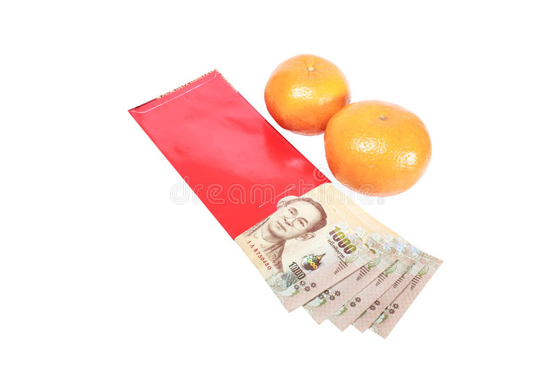 Thai bank note in red envelope and oranges for Chinese new year gift stock photos