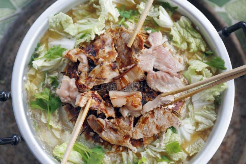Thai barbecue Grill Pork on hot pan buffet, Moo-gata Pork pan It`s traditional Thai style BBQ, barbecue buffet pig pan stock photo