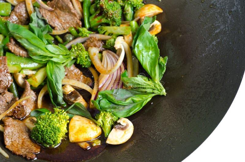 Thai basil beef. In a wok pan stock image