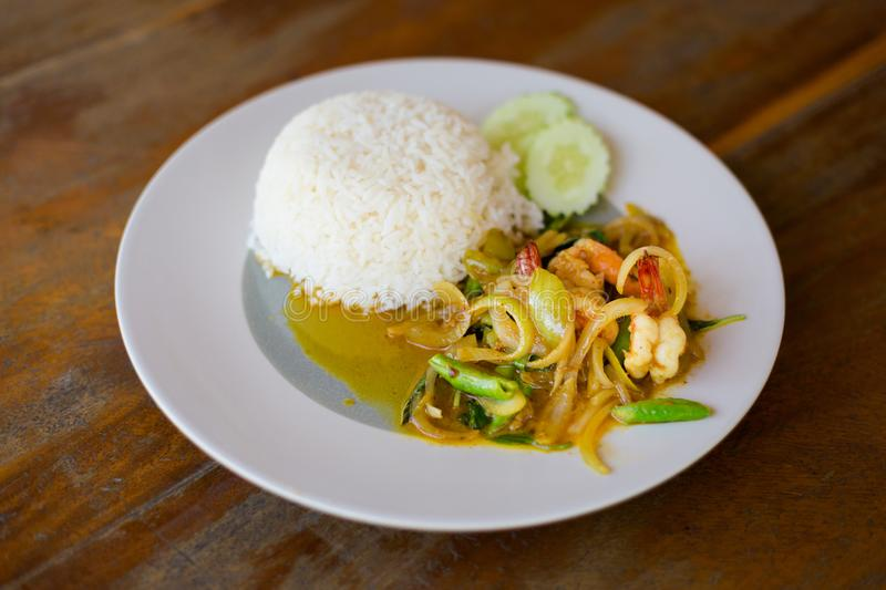 Thai basil prawn with rice. Fresh prepared asian spicy thai basil prawns served with jasmine rice in local restaurant on Koh Mook island. Traditional thai royalty free stock image