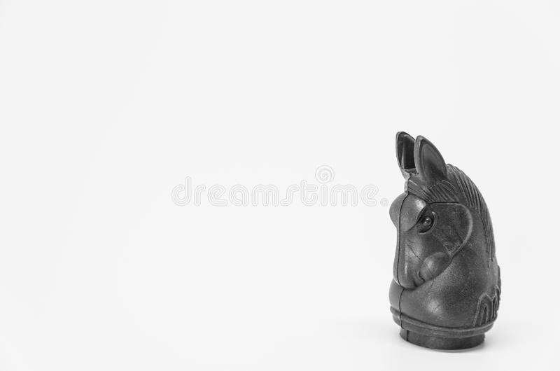 Thai black knight chess piece on white background and selective focus royalty free stock images