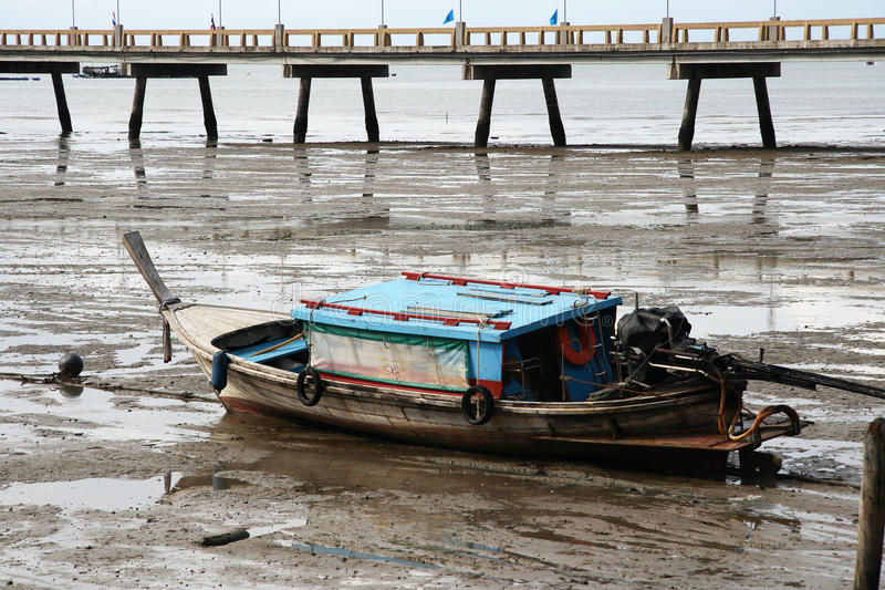 Thai boat and pier low tide royalty free stock images