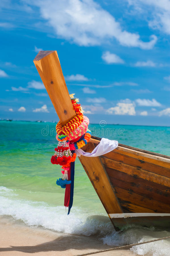 The Thai boat on the shore of the island. stock image