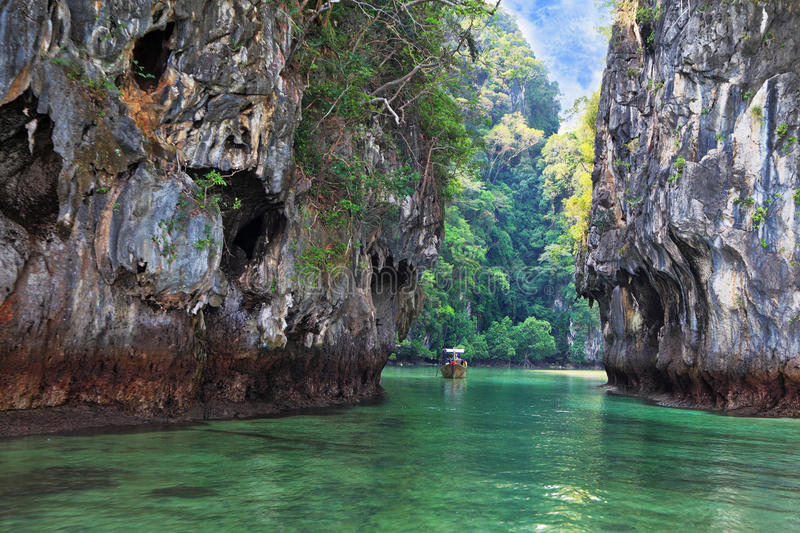 The Thai boat swims in a bay stock photography