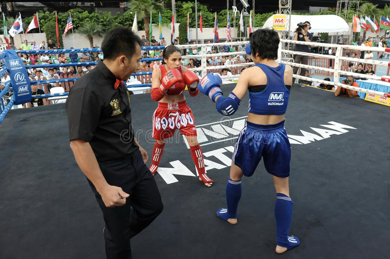 Thai Boxing Match. Female Muay Thai fighters compete in a match in the World Amateur Muay Thai Championships at the National Stadium on March 23, 2012 in Bangkok royalty free stock images