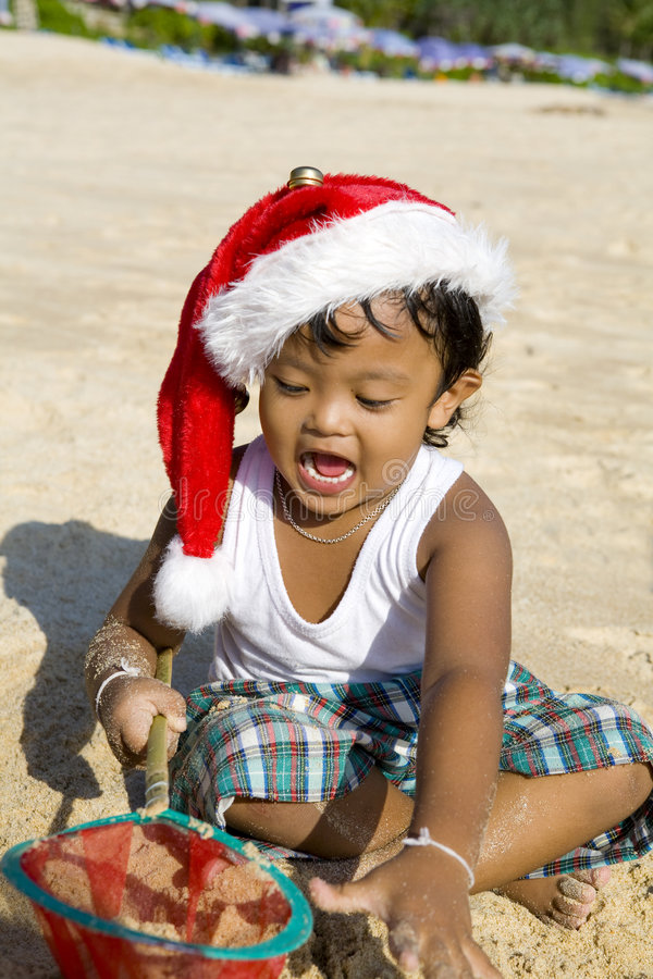 Thai Boy With Christmas Hat On Beach Royalty Free Stock Photos