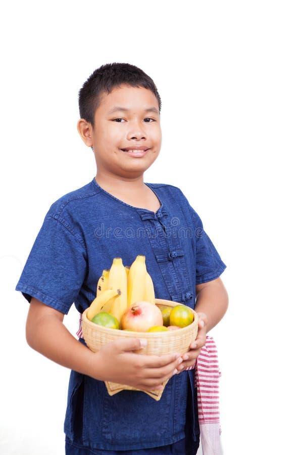 Thai boy with fruit basket stock photo