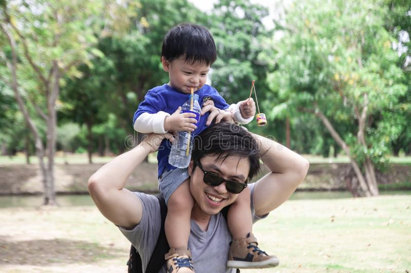Thai boy with mom in the park stock photography
