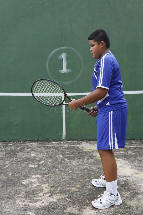 Thai boy tennis player royalty free stock image