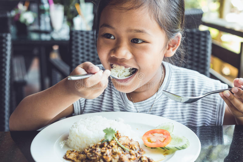 Thai children eating in restaurant stock photography
