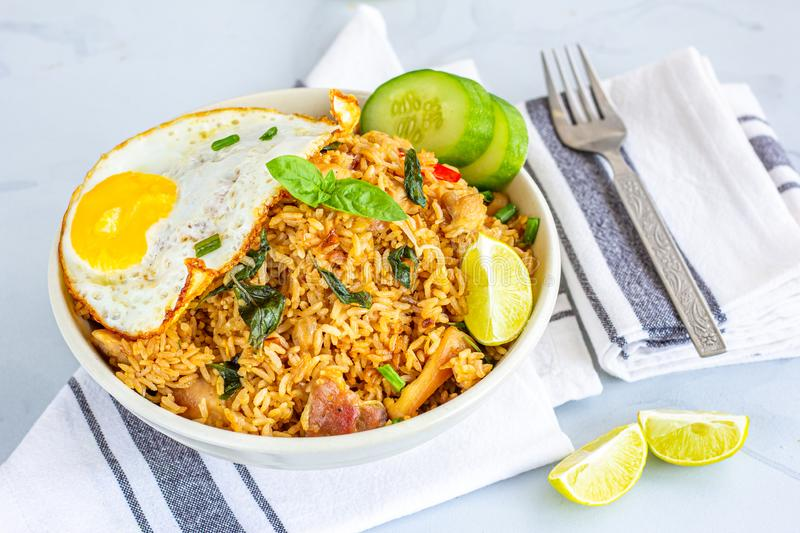 Thai Chili Basil Fried Rice in a Bowl, Thai Food, Thai Cuisine Photography. Thai Chili Basil Fried Rice with Fried Egg on Top. Fried Rice with Vegetables and royalty free stock photo