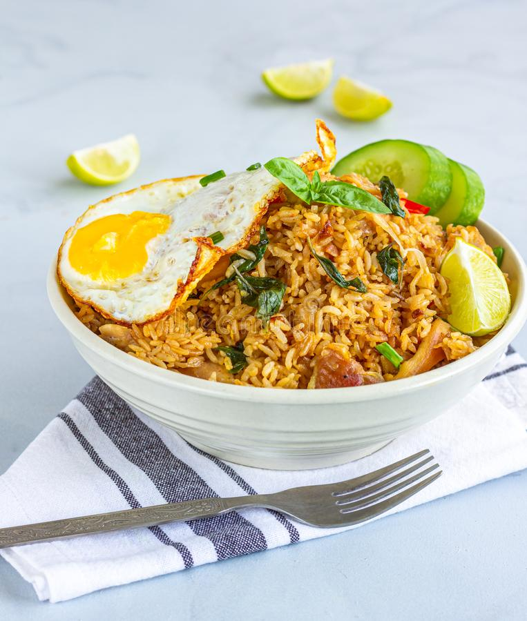Thai Chili Basil Fried Rice with Fried Egg on Top. Fried Rice with Vegetables and Fried Egg, Thai Cuisine, Thai Food, Asian Food Photography royalty free stock images