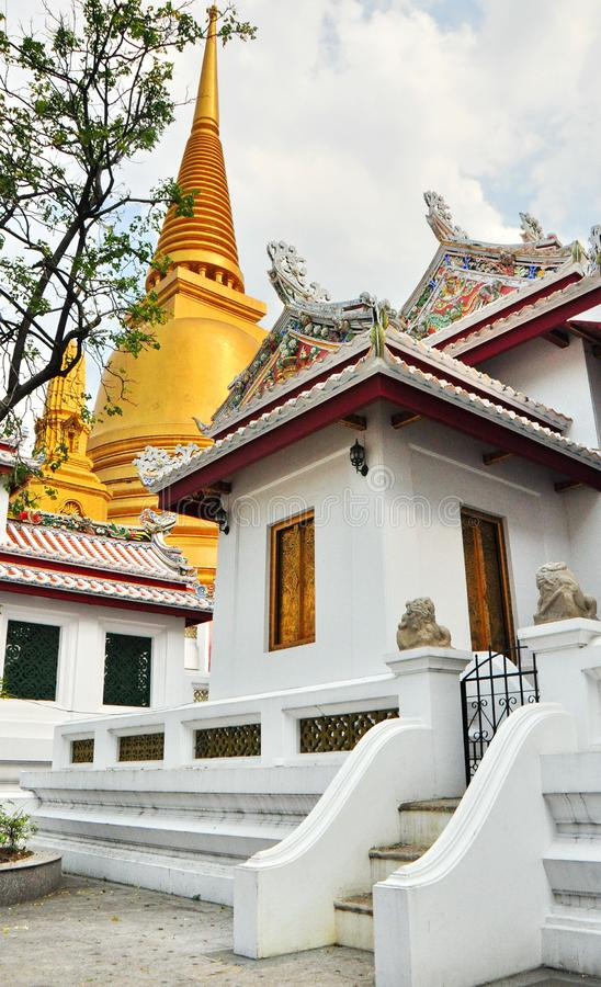 Thai and Chinese Buildings. The golden chedi of Thailand, coupled with the temple is a style of Chinese art royalty free stock photography