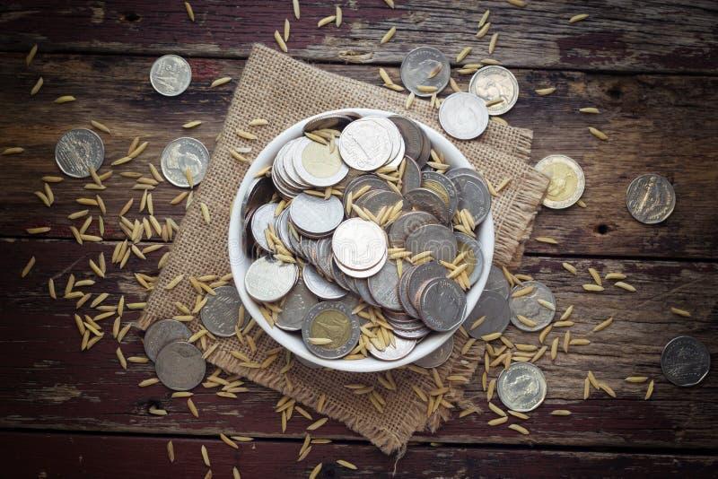 Thai Coins. Thai Baht Coins in a cup royalty free stock photo
