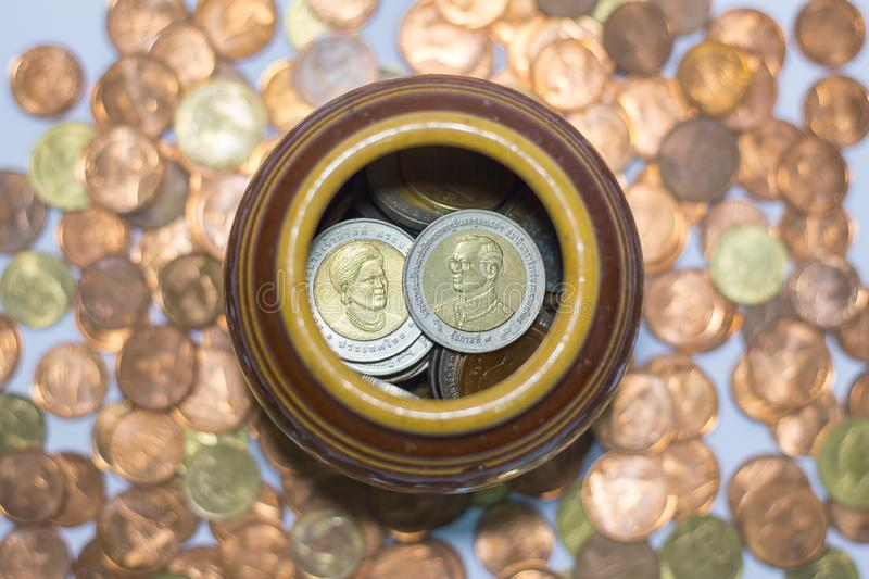 Thai coins in a jar royalty free stock photo