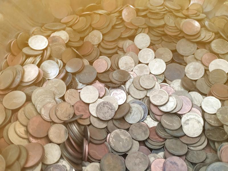 Thai coins in monk alms bowl royalty free stock photography