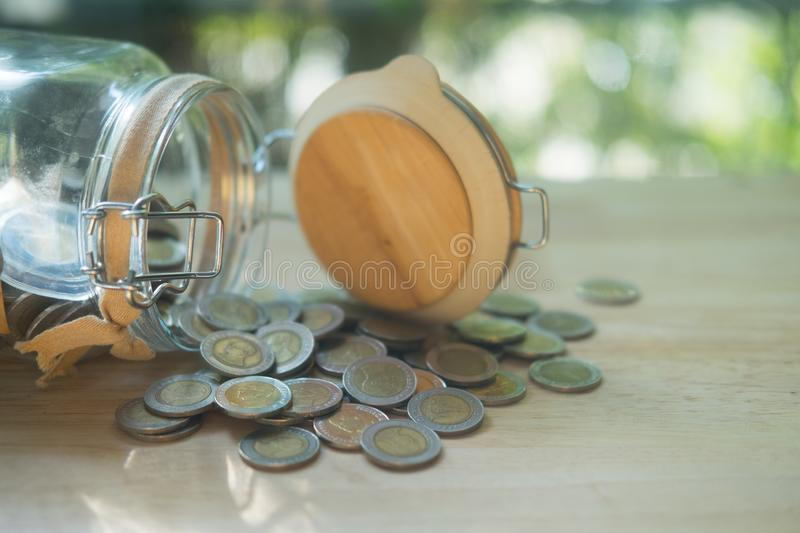 Thai coins in and outside the glass jar, Thai Baht currency stock photos