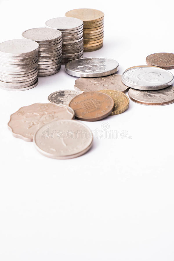 Thai coins stack. Savings, Thai coins stack and International coins mixed on white background stock photos