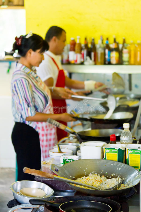 Thai cook at work in local restaurant royalty free stock photo