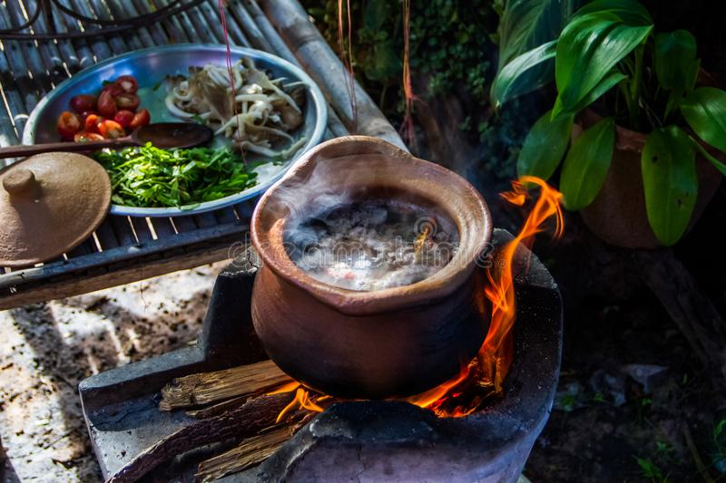 Thai cooking. In earthen pot stock image