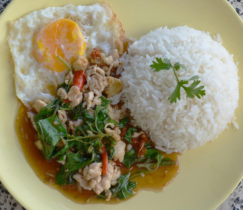 Thai cuisine, basil fried rice and fried egg. stock images