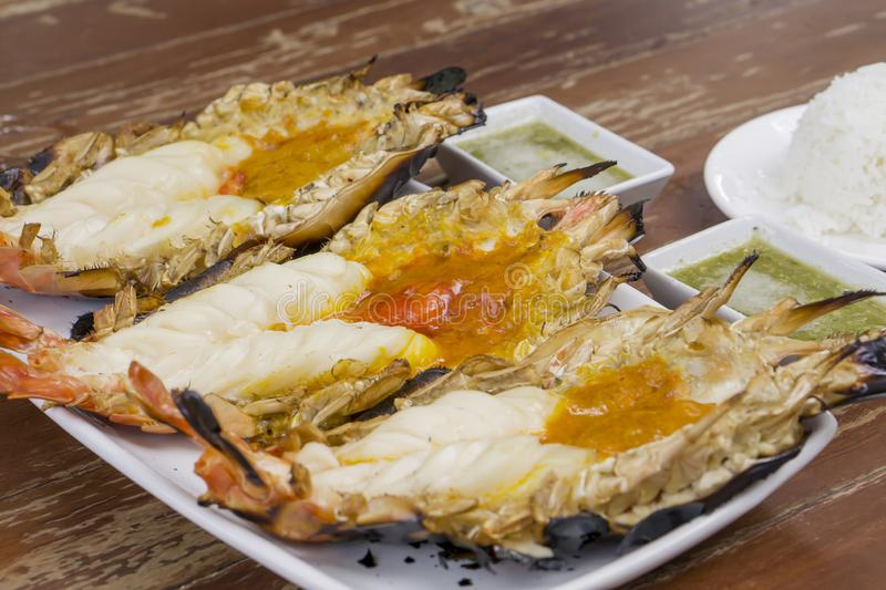 Thai cuisine style, Grilled giant river shrimp. Thai cuisine style, Grilled fresh giant river shrimp or prawn, cutting half and burn served with Thai spicy sauce stock photos