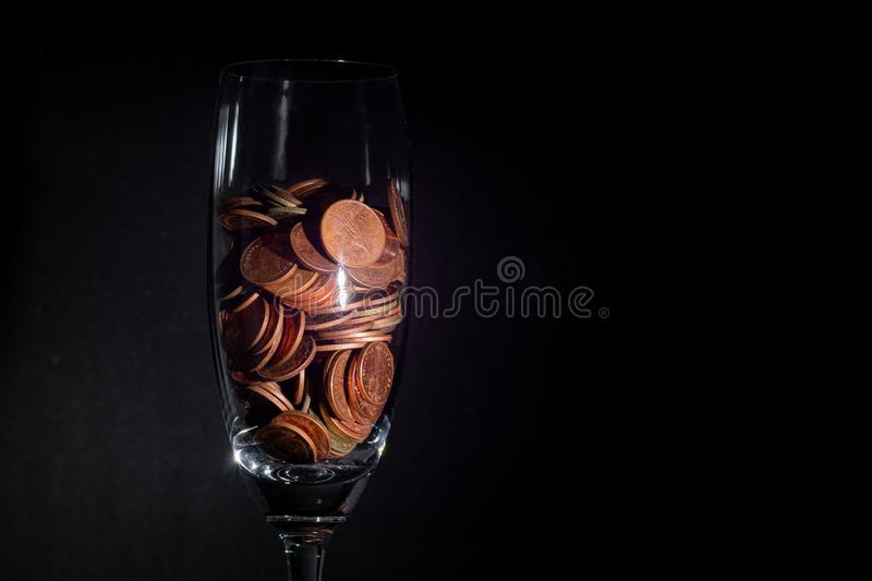 Thai currency coins in glass black background royalty free stock image