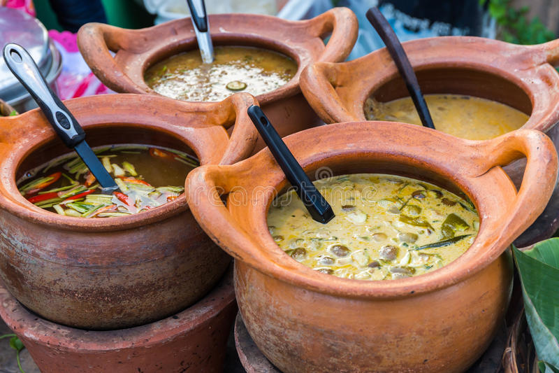 Thai curry in the clay pot. Thai curry in the clay pot for sale at market in Thailand stock photo