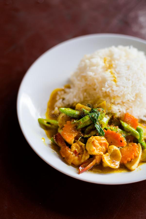 Thai curry seafood Koh Mook. Fresh prepared asian spicy curry seafood served with jasmine rice in local restaurant on Koh Mook island. Traditional thai cuisine royalty free stock photo