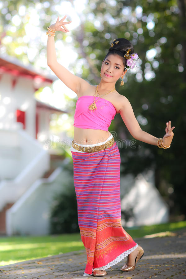 Thai dancing girl with northern style dress in temple. Chiang Mai, Thailand stock image