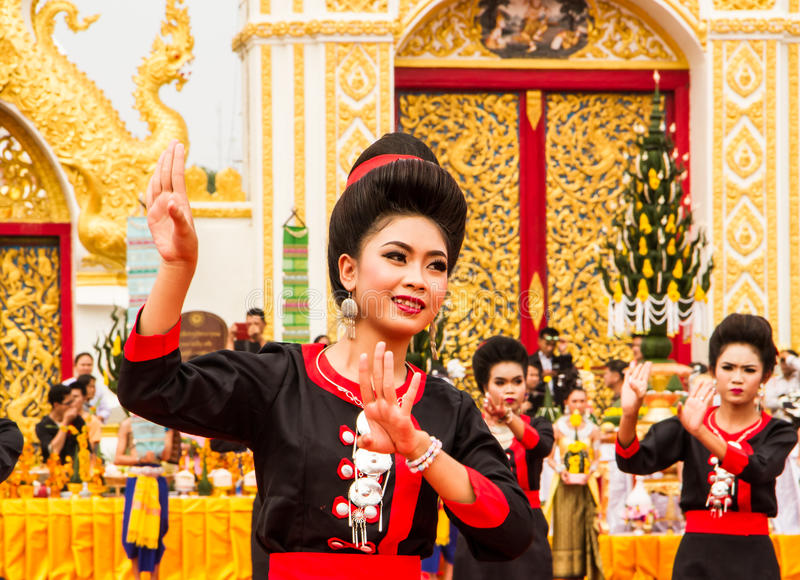 Thai dancing performance. NAKHON PHANOM ,THAILAND-OCTOBER 8: A group of Thai dancers perform Thai dancing in front of Pratat Pranom pagoda on 8 October 2014 at stock photos