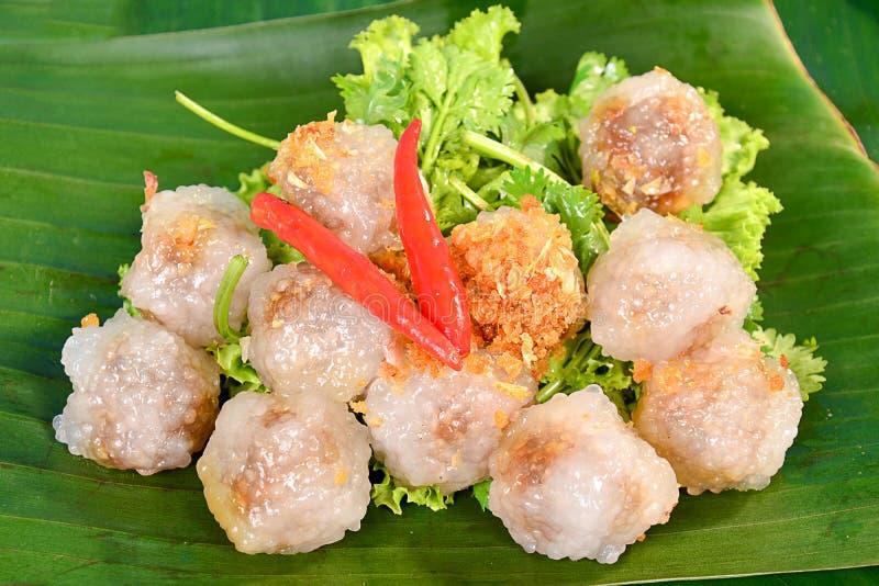 Thai deserts kanom sago on banana leaf royalty free stock photos