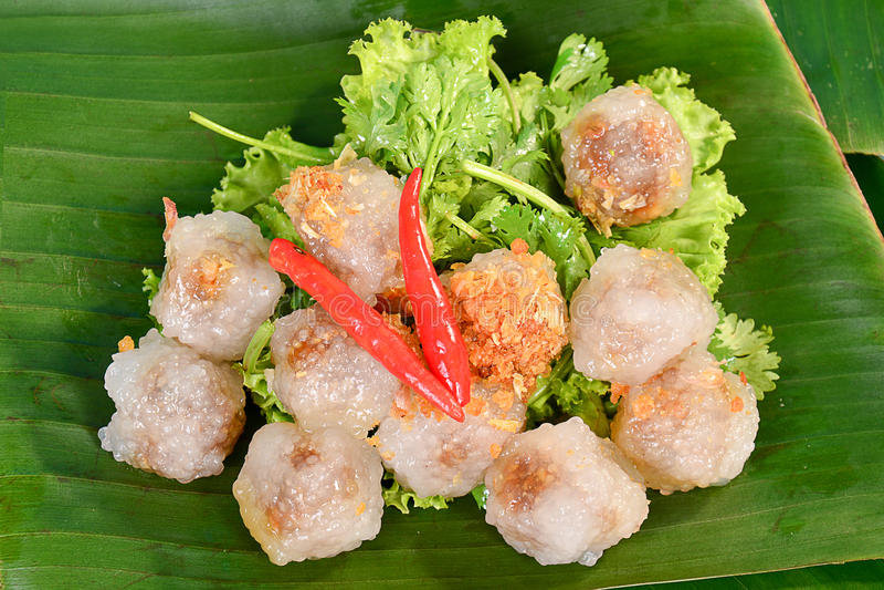 Thai deserts kanom sago on banana leaf royalty free stock images