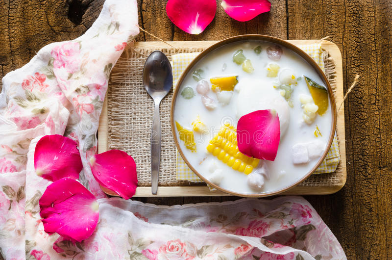 Thai dessert. A famous of thai sweet made from flour and coconut cream adding boiled egg and cereal docorate with pink rose petal stock images