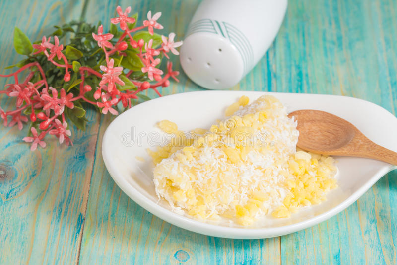 Thai dessert kanom Tua Pab ,Mung Bean rice-crepe. Coconut, sesame seeds, and covered in coconut flakes royalty free stock image