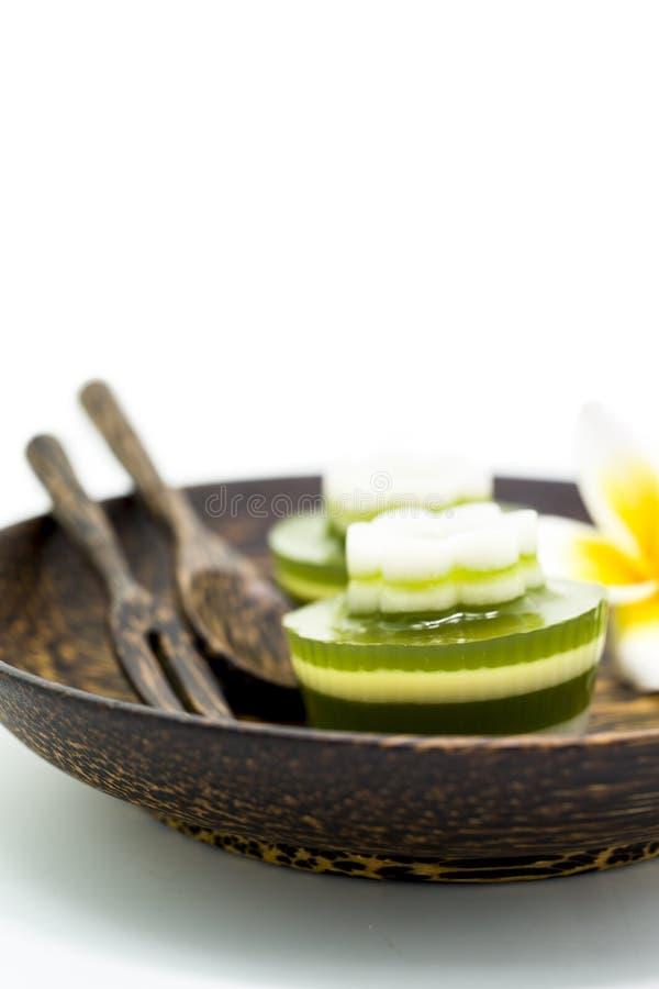 Thai dessert, pandan Jelly serve on palm wood dish. The name of Thai is Woon Bai Toey stock image