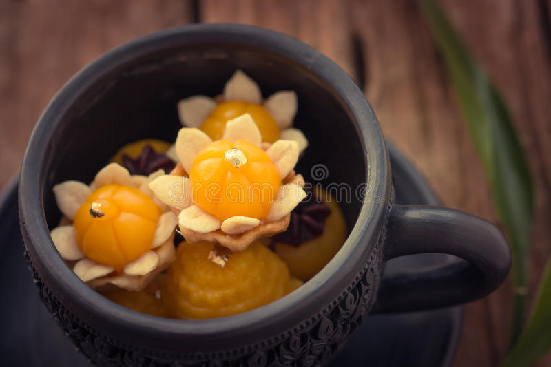 Thai dessert present. Well known traditional thai dessert present in dish on wooden royalty free stock images