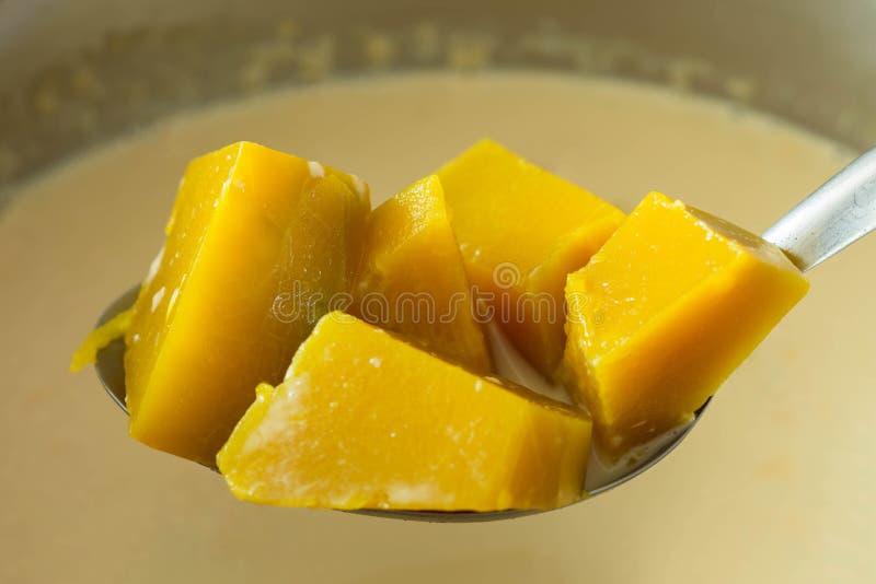 Thai Dessert, pumpkin in sweet coconut milk close up royalty free stock photo