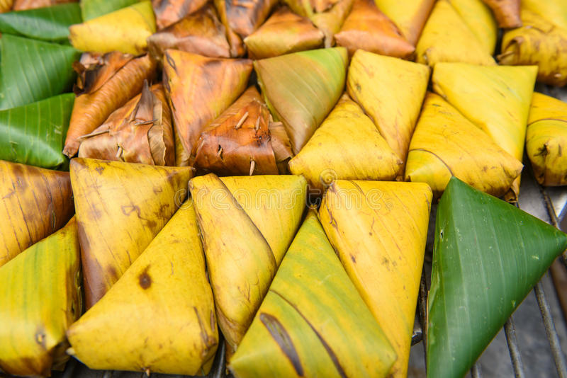 thai dessert - Sticky rice custard wrapped in banana leaf at tha royalty free stock photo