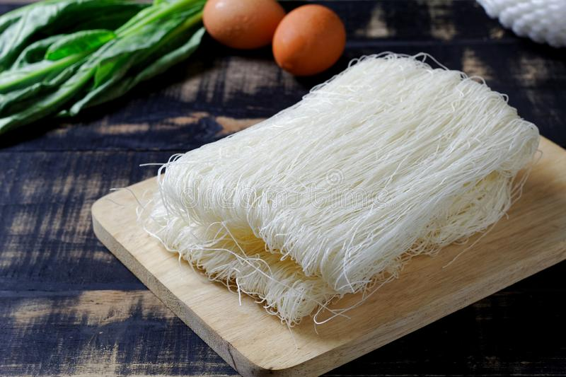 Thai died Rice Vermicelli on wood board,Uncooked.  royalty free stock photography
