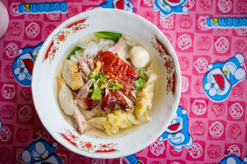 Thai dimsum duck clear soup. Fresh prepared asian aromatic duck broth soup with dimsum dumplings, pork meat balls and noodles in local restaurant on koh Lanta royalty free stock images