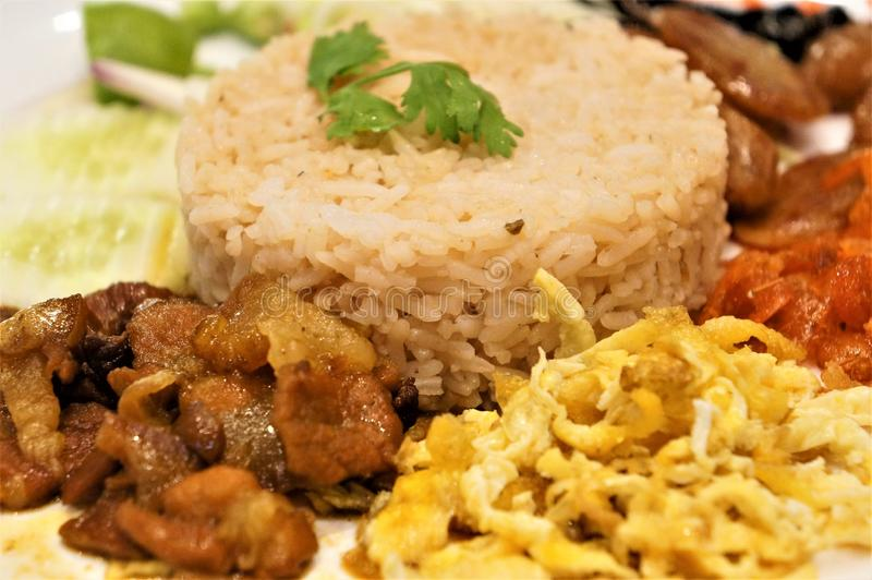 Close-up on a fried rice and shrimps paste dish. Thai dish, fried rice, shrimps paste, fried pork and fried eggs stock photos