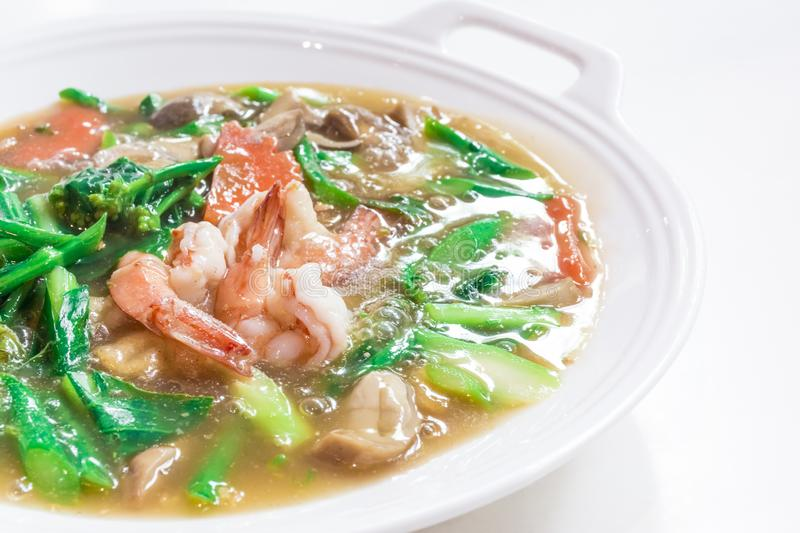 """Thai Dishes called """"Rad Na"""", Wide Rice Noodles Seafood in Gravy, Chinese food. Asian, best, clean, cooking, course, creamy, cuisine, delicious royalty free stock images"""