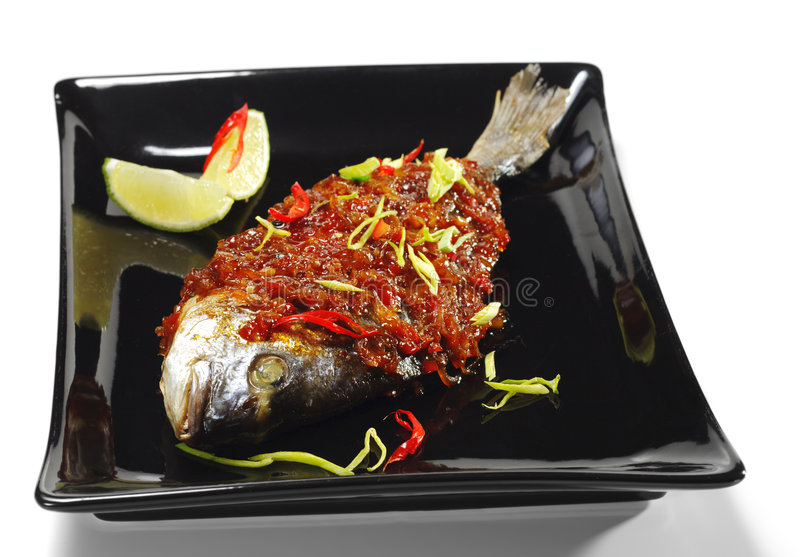 Thai Dishes - Grilled Dorado. With Ginger Sauce royalty free stock photos