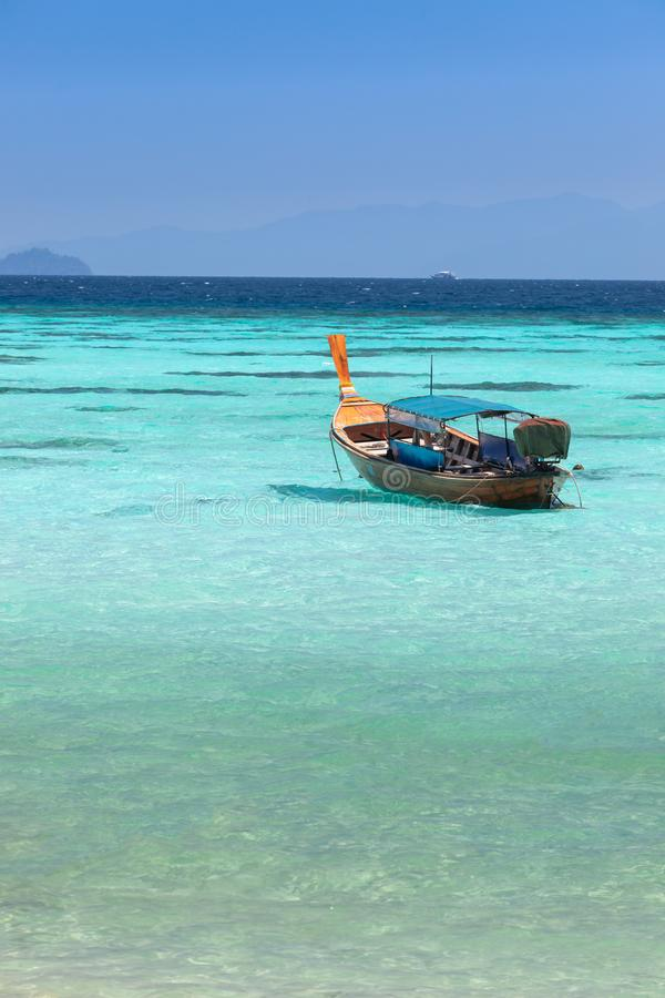 Thai diving boat in a clear blue sea at Koh Lipe royalty free stock photo