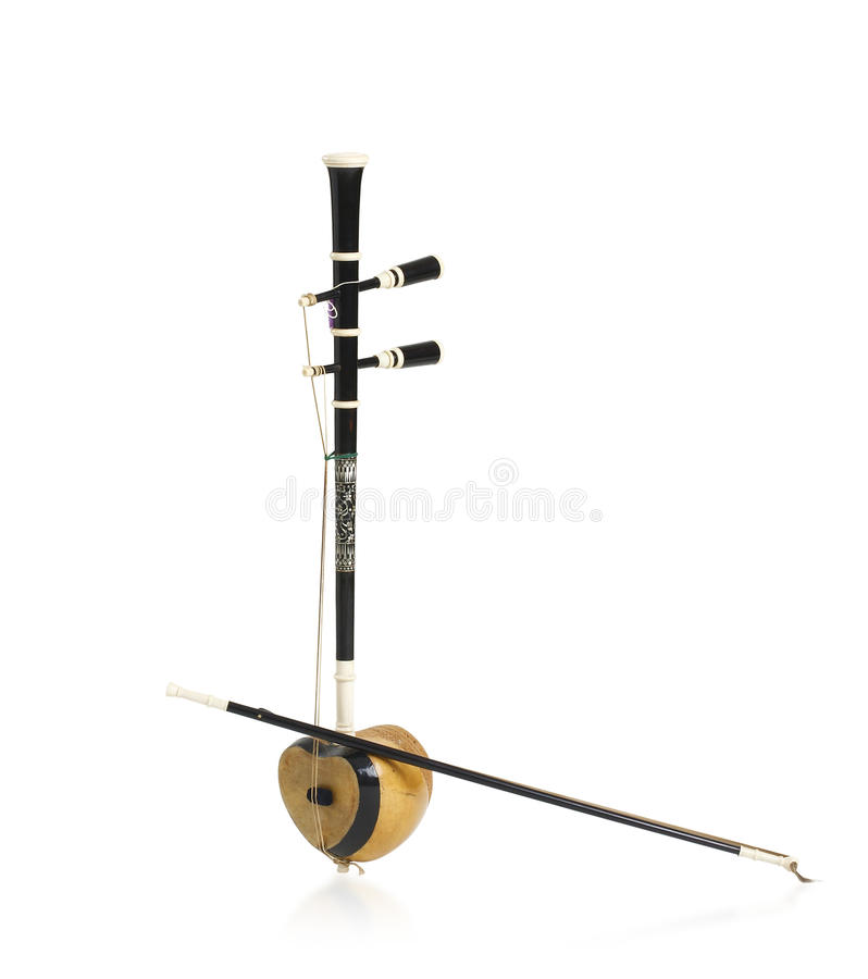 Thai fiddle bass sounded string music instrument. On white background royalty free stock photography