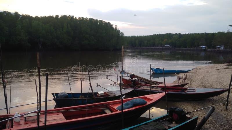 Thai fisherman come to home stock photo