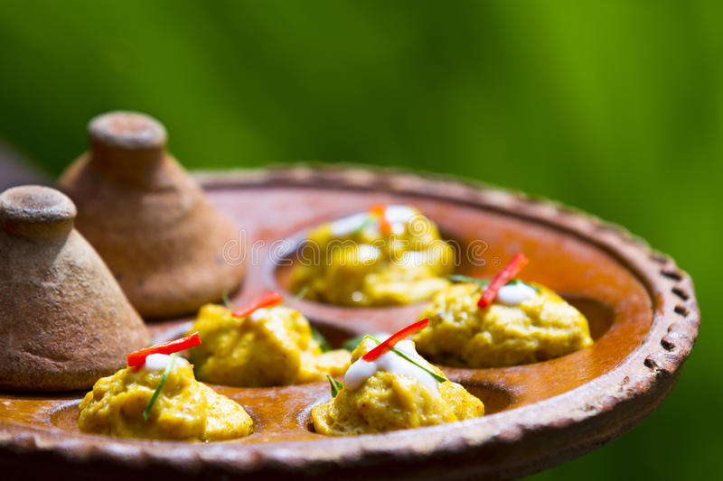 Thai food. Baked curried fish paste on earthenware stock photography